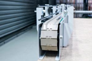 Пластинчатый конвейер от завода конвейерного оборудования Траяна в Москве